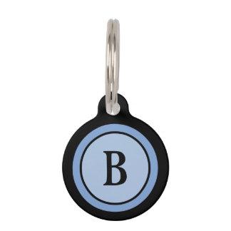 Monograma negro y azul de la etiqueta de la identi identificador para mascota