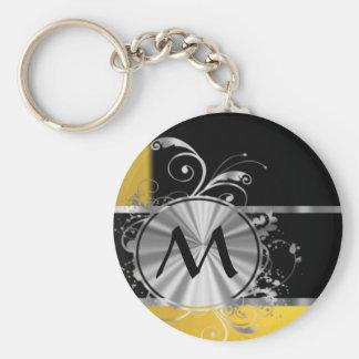 Monograma negro y de plata amarillo llaveros