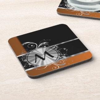Monograma negro y de plata de cobre posavasos de bebidas