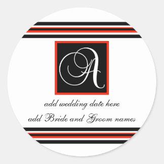 Monograma negro y rojo de la raya pegatinas de un pegatina redonda