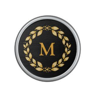 Monograma romano con hojas de oro adornado de la altavoz bluetooth