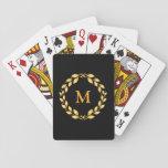 Monograma romano con hojas de oro adornado de la cartas de póquer