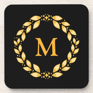 Monograma romano con hojas de oro adornado de la posavaso