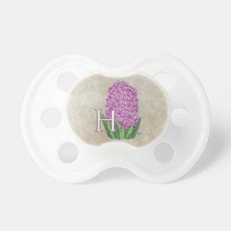 Monograma rosado de la flora del jacinto chupetes de bebe