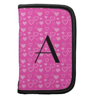 Monograma rosado de los corazones planificadores
