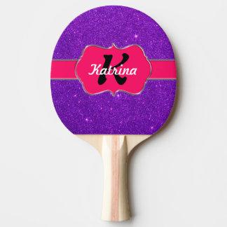 Monograma rosado de neón en brillo púrpura pala de ping pong