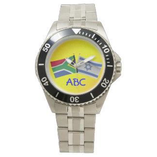 Monograma surafricano y reloj de la bandera de