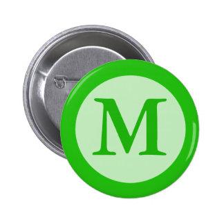 monograma verde pin redondo de 2 pulgadas