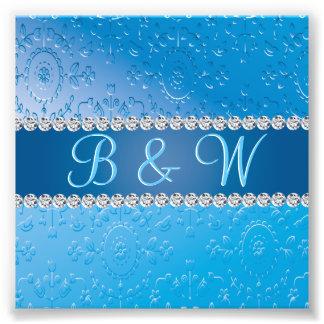 Monogramas azules grabados en relieve del cojinete