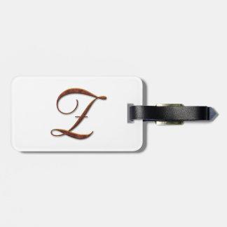 Monogramas de bronce de la arcilla etiquetas maleta