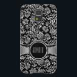 "Monogramed Black &amp; Silve Metallic Floral Damasks 2 Galaxy S5 Case<br><div class=""desc"">Elegant black and silver tones shiny metallic look with floral damasks pattern. Custom and optional monogram. See this silver damasks with different monogram.</div>"