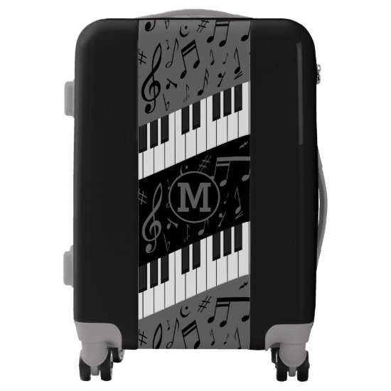 Monogrammed curve piano keys and musical notes luggage