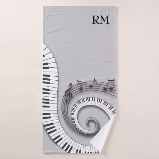 Monogrammed curved piano keys and musical notes on bath towel set
