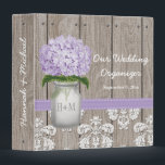 """Monogrammed Mason Jar Purple Hydrangea Wedding 3 Ring Binder<br><div class=""""desc"""">Pretty rustic style monogrammed mason jar binder with a lavender and light purple hydrangea flower and a wooden fence and antique damask pattern lace background and stitched pink ribbon. This wedding organizer can be personalized with the initials and monogram of the bride and groom on the mason jar and customized...</div>"""