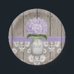 "Monogrammed Mason Jar Purple Hydrangea Wedding Paper Plate<br><div class=""desc"">Pretty rustic style monogrammed mason jar paper plate with a light purple hydrangea flower and a wooden fence and antique damask pattern lace background and stitched lavender ribbon. This wedding or bridal shower or couples shower, engagement or anniversary party plate personalized with the initials and monogram of the happy couple...</div>"