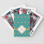 "Monogrammed Teal Gold Moroccan Bicycle Playing Cards<br><div class=""desc"">An elegant and trendy,  jewel toned Moroccan pattern with a printed ribbon look design in gold and a teal blue green hue. It can be personalized with your monogram or initial on it. Artwork and design &#169; Chrissy H. Studios,  LLC. All Rights Reserved.</div>"