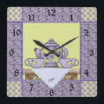 "Monogrammed Teapot Quilt Patch Wall Clock<br><div class=""desc"">Personalize this teapot themed wall clock in mint and lilac colors with a monogram. Just edit in the easy Zazzle text editor.  Great gift for tea lovers,  quilters alike. Created in part with graphics by Alice Smith from www.digiwebstudio.com and Cheryl Seslar of www.raggedyscrappin.com sold at www.scrappindoodles.com by Scrappin Doodles</div>"