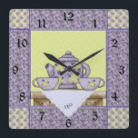 """Monogrammed Teapot Quilt Patch Wall Clock<br><div class=""""desc"""">Personalize this teapot themed wall clock in mint and lilac colors with a monogram. Just edit in the easy Zazzle text editor.  Great gift for tea lovers,  quilters alike. Created in part with graphics by Alice Smith from www.digiwebstudio.com and Cheryl Seslar of www.raggedyscrappin.com sold at www.scrappindoodles.com by Scrappin Doodles</div>"""
