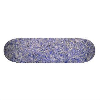 Monopatín del efecto de la piedra azul