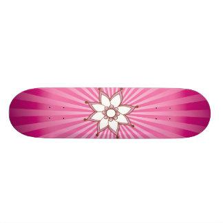 Monopatín del resplandor solar de la flor de la al patin