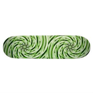 Monopatín verde abstracto de los huevos patín