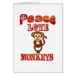 Monos del amor de la paz felicitacion