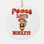 Monos del amor de la paz ornatos