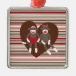 Monos del calcetín en regalos del corazón del el ornamento para reyes magos