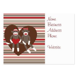 Monos del calcetín en regalos del corazón del el tarjetas de visita grandes