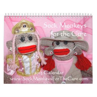 Monos del calcetín para el calendario de pared de