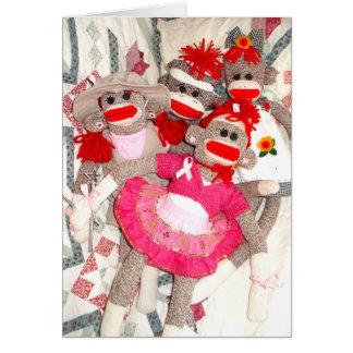 Monos del calcetín para el manojo de la curación d felicitación