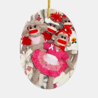 Monos del calcetín para el ornamento del óvalo de adorno navideño ovalado de cerámica