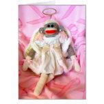 Monos del calcetín para la tarjeta del ángel de la