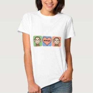 Monos lindos del clip art del dibujo animado con camisas