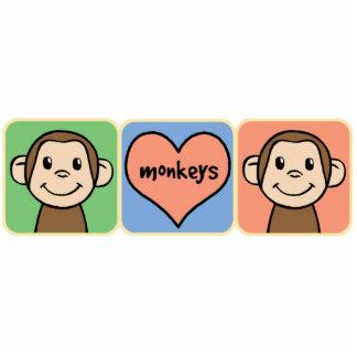 Monos lindos del clip art del dibujo animado con fotoescultura vertical