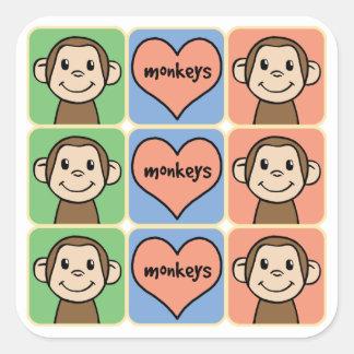 Monos lindos del clip art del dibujo animado con pegatina cuadrada