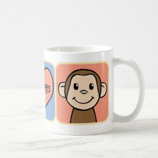 Monos lindos del clip art del dibujo animado con taza