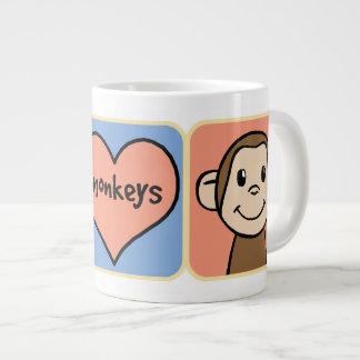 Monos lindos del clip art del dibujo animado con taza grande