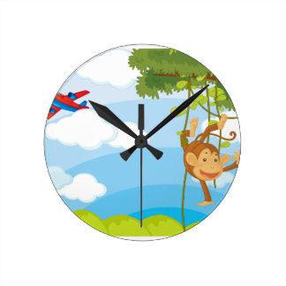 monos reloj de pared