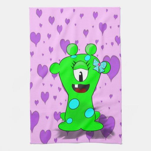 Monstruo adorable del verde del bebé en fondo de l toallas de cocina