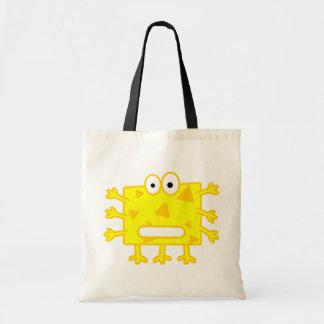 Monstruo amarillo lindo del dibujo animado bolsa