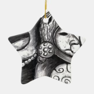 Monstruo azteca adorno de cerámica en forma de estrella