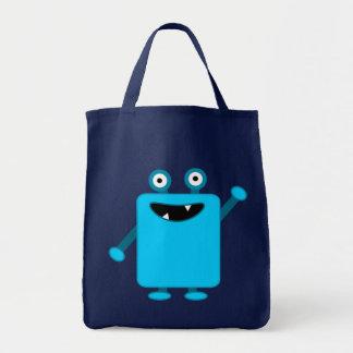 Monstruo azul claro lindo del dibujo animado bolsas de mano