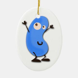Monstruo azul lindo de la haba adorno navideño ovalado de cerámica