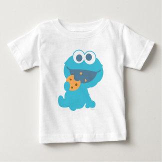 Monstruo de la galleta que come la galleta playera de bebé