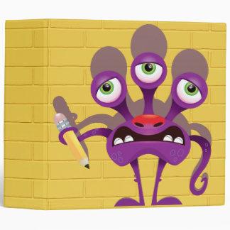 monstruo divertido con el cuaderno del lápiz