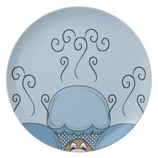 Monstruo lindo con las magdalenas heladas azul plato
