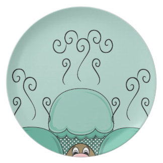 Monstruo lindo con las magdalenas heladas ciánicas platos