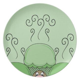 Monstruo lindo con las magdalenas heladas verde platos de comidas