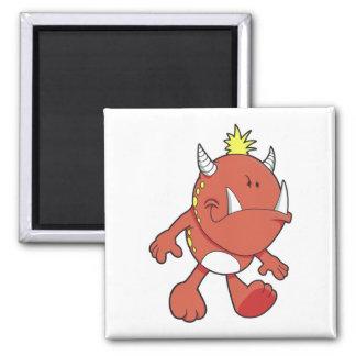monstruo lindo del colmillo del fuego que pone mal iman de frigorífico